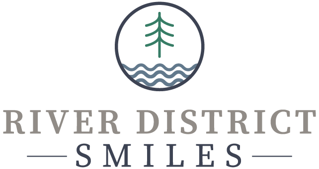 river district smiles logo